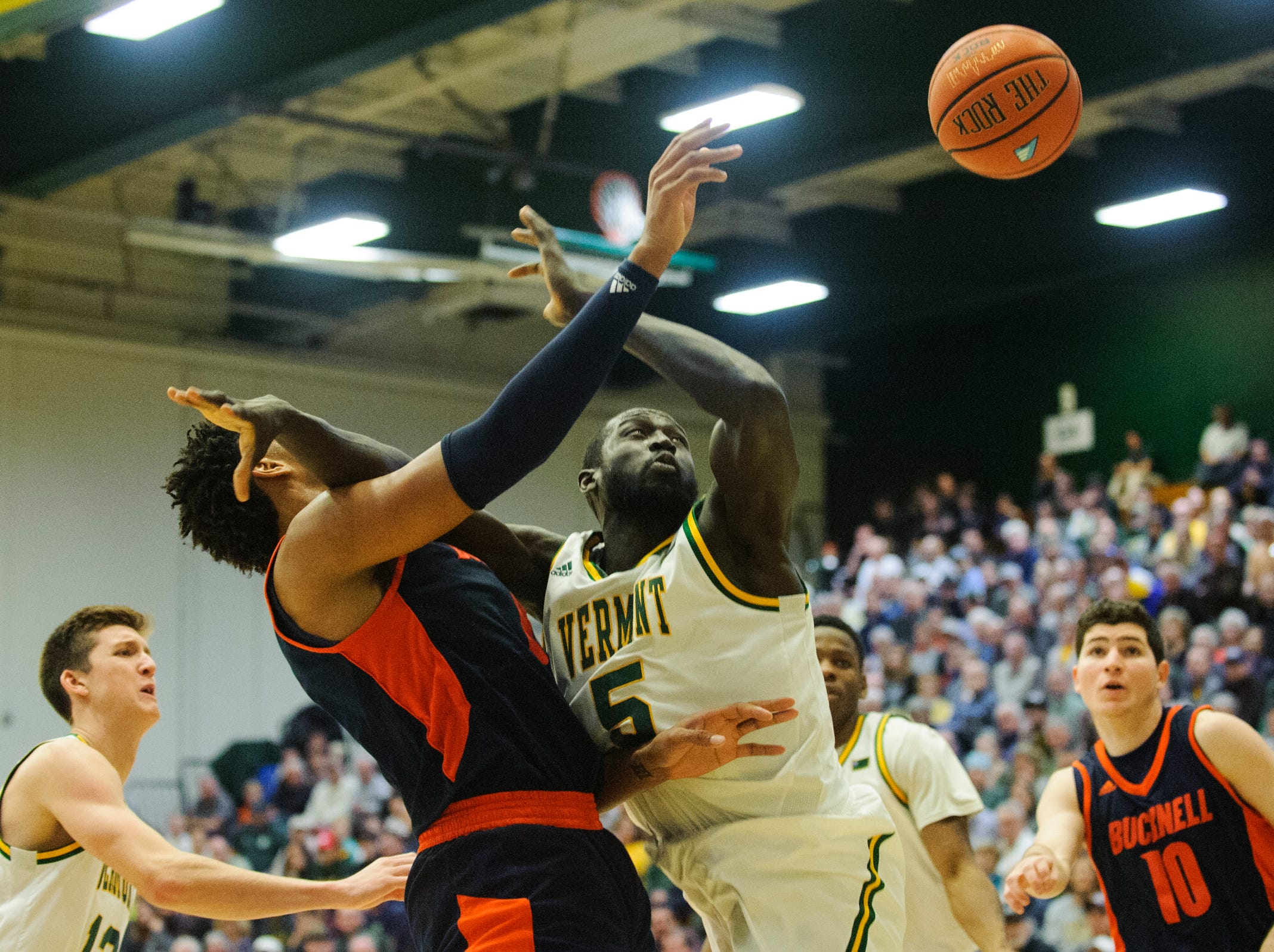Vermont forward Samuel Dingba (5) battles for the rebound during the men's basketball game between the Bucknell Bison and the Vermont Catamounts at Patrick Gym on Sunday afternoon November 25, 2018 in Burlington.