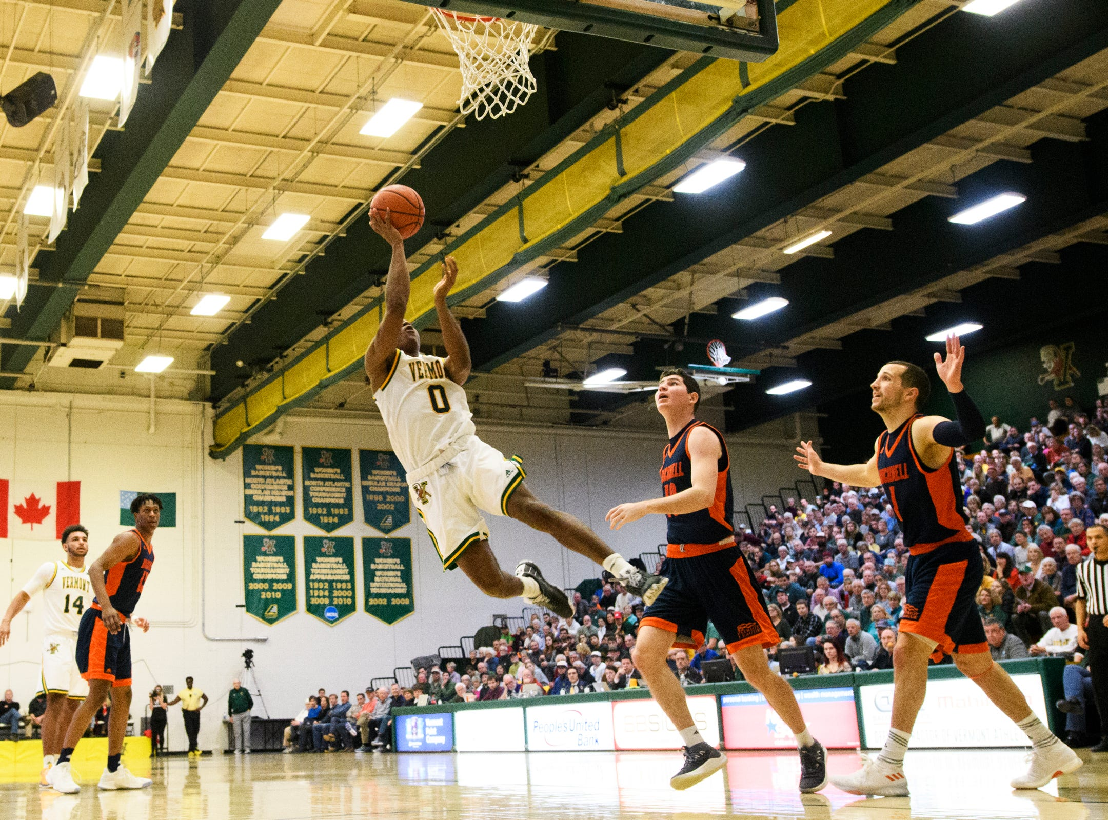 Vermont guard Stef Smith (0) leaps for a lay up during the men's basketball game between the Bucknell Bison and the Vermont Catamounts at Patrick Gym on Sunday afternoon November 25, 2018 in Burlington.