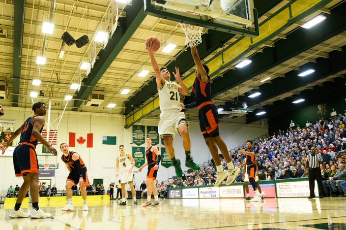 Vermont guard Everett Duncan (21) leaps for a lay up during the men's basketball game between the Bucknell Bison and the Vermont Catamounts at Patrick Gym on Sunday afternoon November 25, 2018 in Burlington.