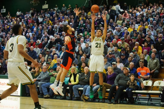 Vermont guard Everett Duncan (21) shoots a three pointer during the men's basketball game between the Bucknell Bison and the Vermont Catamounts at Patrick Gym on Sunday afternoon November 25, 2018 in Burlington.
