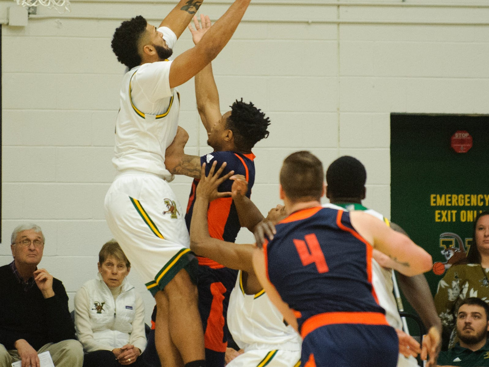 Vermont forward Anthony Lamb (3) leaps to block a shot during the men's basketball game between the Bucknell Bison and the Vermont Catamounts at Patrick Gym on Sunday afternoon November 25, 2018 in Burlington.