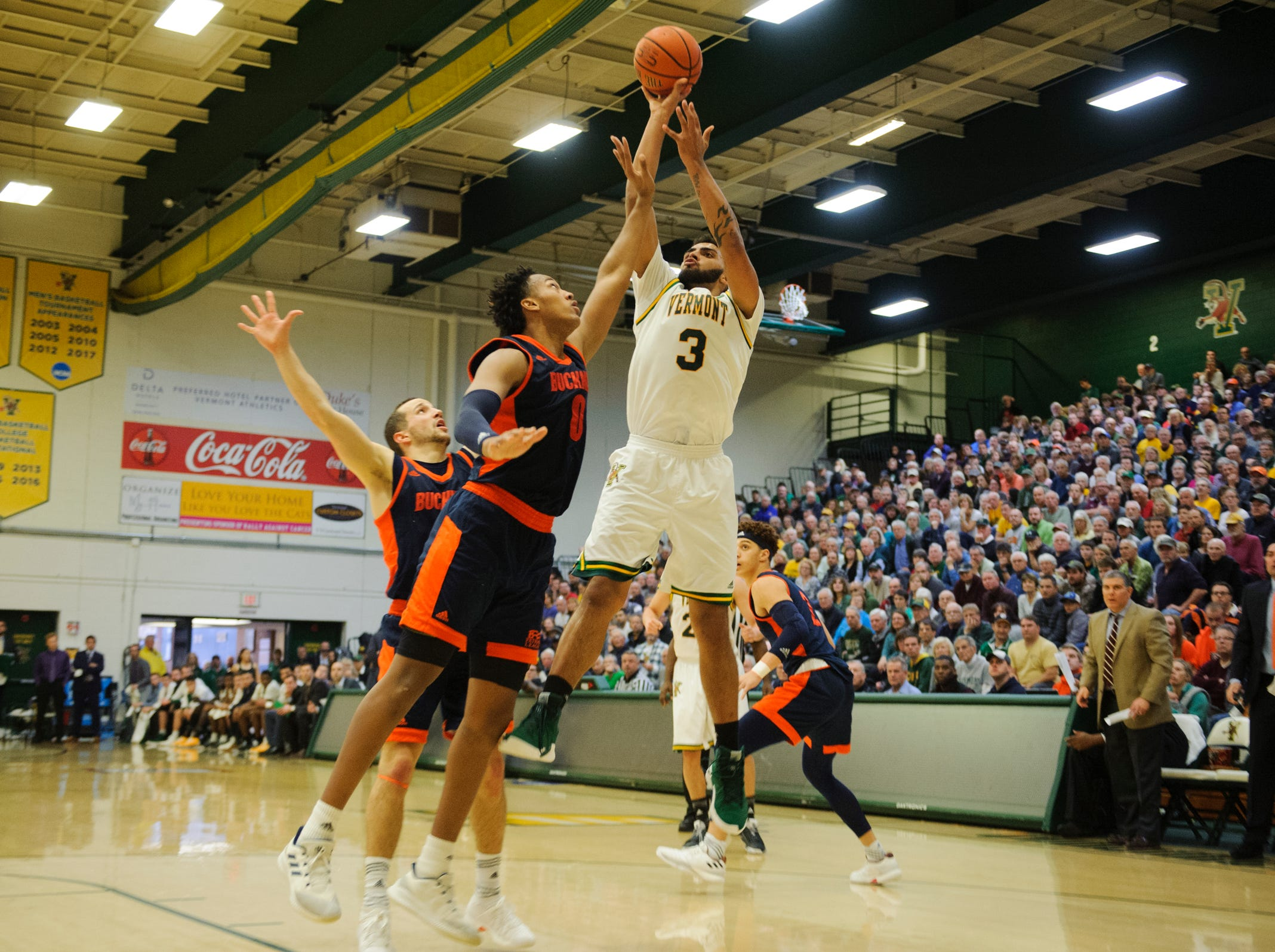 Vermont forward Anthony Lamb (3) shoots the ball over Bucknell's Paul Newman (0) during the men's basketball game between the Bucknell Bison and the Vermont Catamounts at Patrick Gym on Sunday afternoon November 25, 2018 in Burlington.