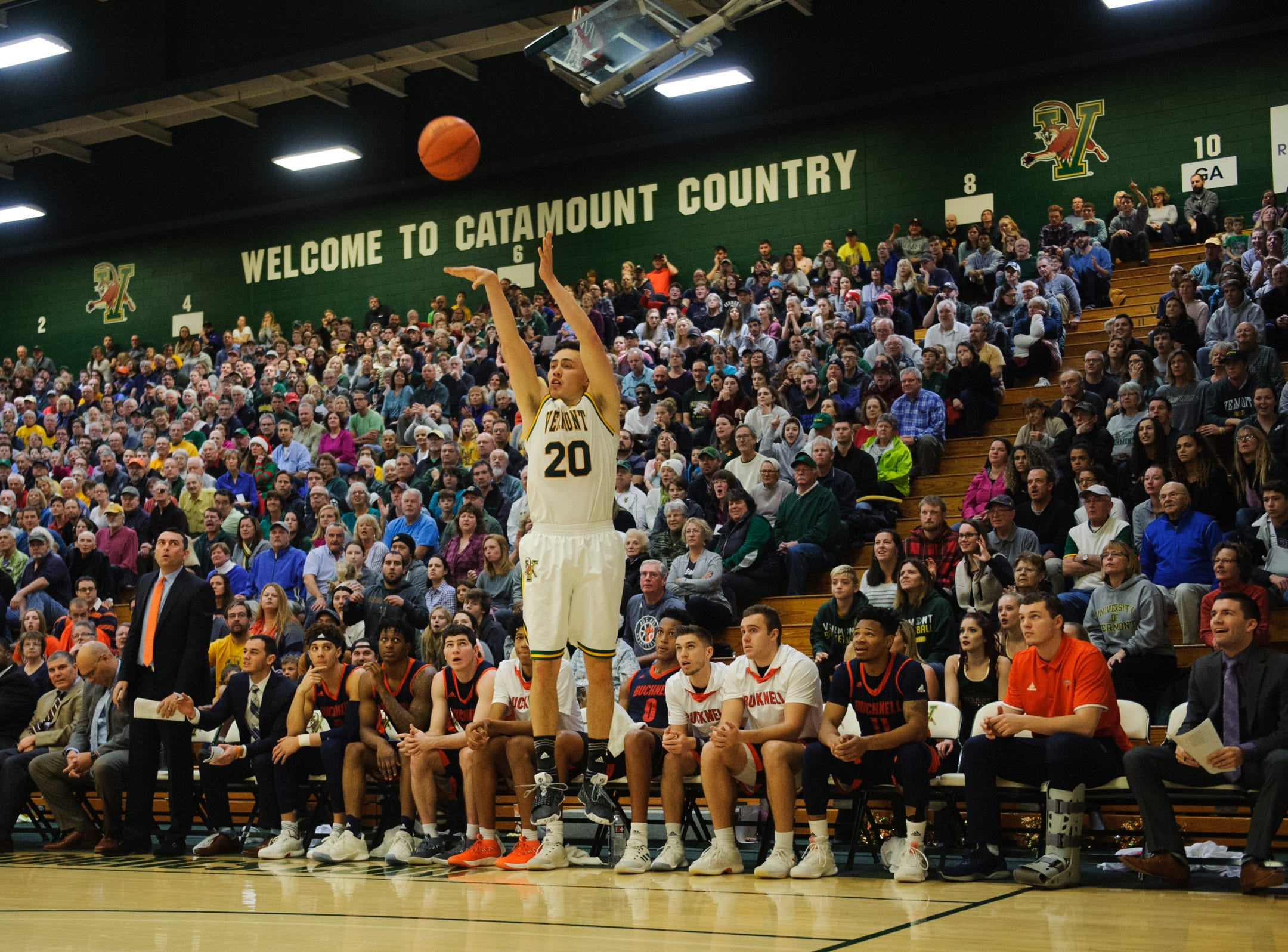 Vermont guard Ernie Duncan (20) shoots a wide open three pointer during the men's basketball game between the Bucknell Bison and the Vermont Catamounts at Patrick Gym on Sunday afternoon November 25, 2018 in Burlington.