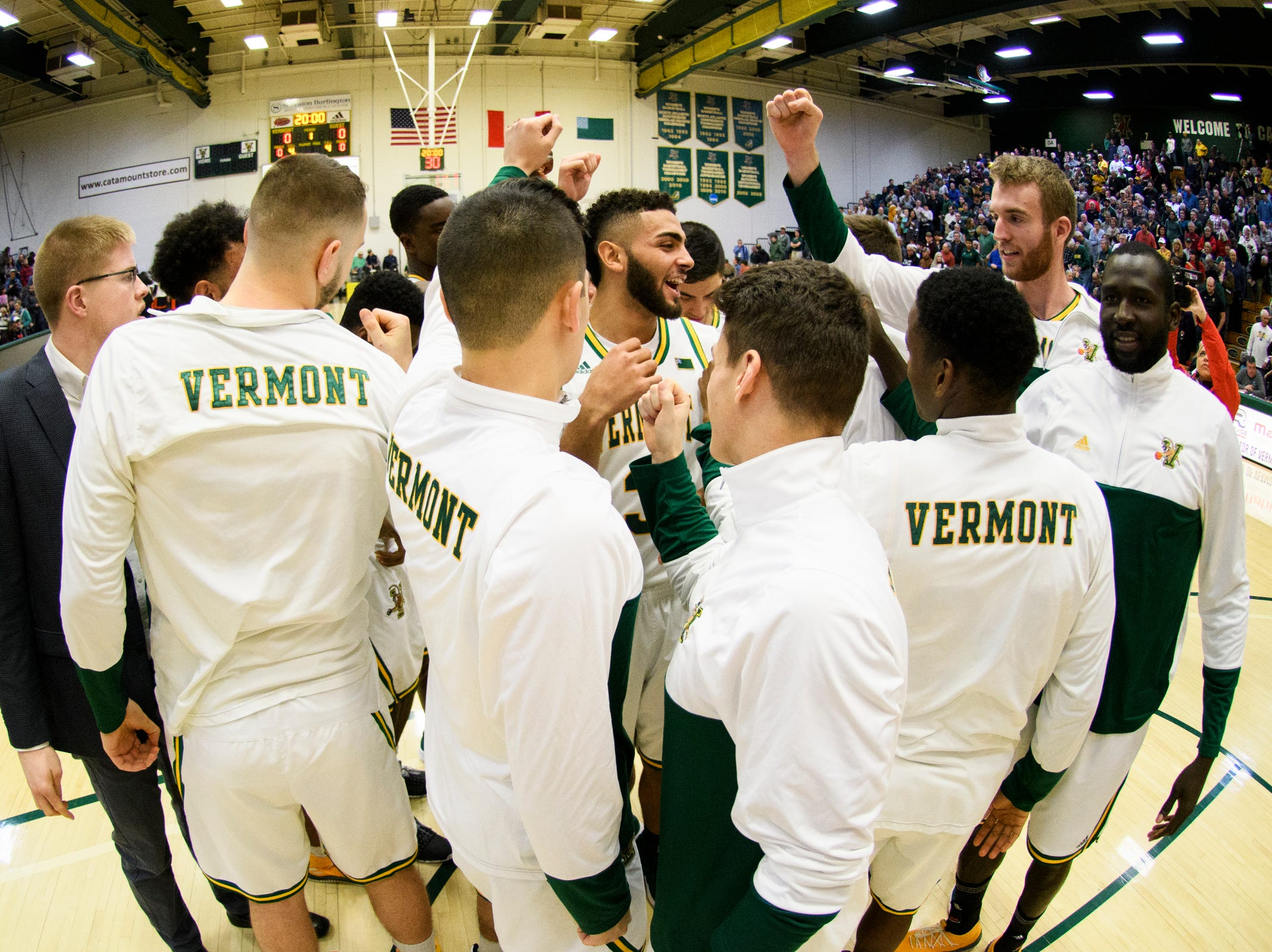 Vermont huddles together during the men's basketball game between the Bucknell Bison and the Vermont Catamounts at Patrick Gym on Sunday afternoon November 25, 2018 in Burlington.