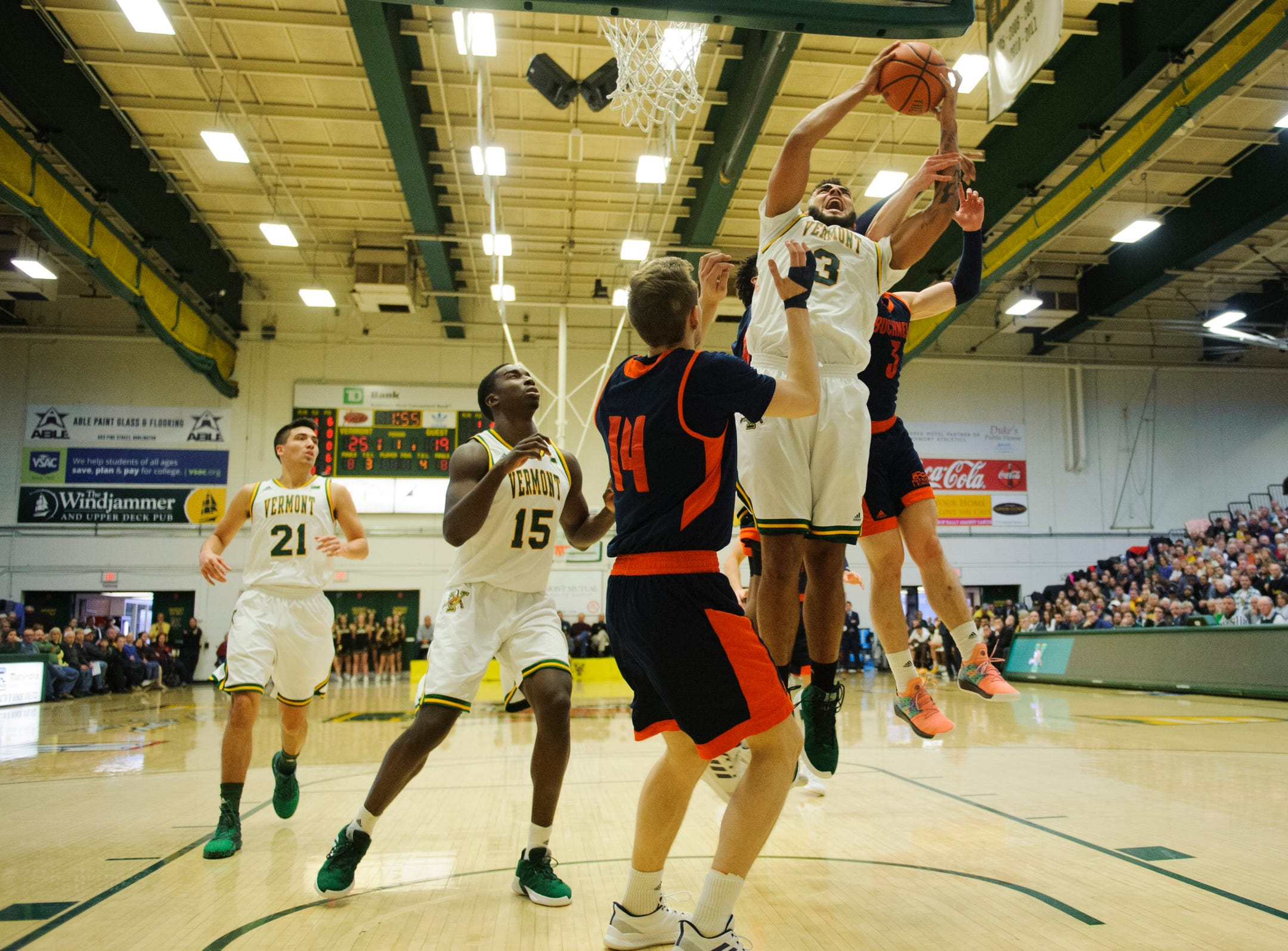 Vermont forward Anthony Lamb (3) leaps for a lay up during the men's basketball game between the Bucknell Bison and the Vermont Catamounts at Patrick Gym on Sunday afternoon November 25, 2018 in Burlington.