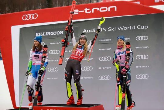 United States' Mikaela Shiffrin, center, winner of the alpine ski, women's World Cup slalom, celebrates on the podium with second placed Slovakia's Petra Vlhova, left, and third placed Sweden's Frida Hansdotter, in Killington, Vt., Sunday, Nov. 25, 2018.