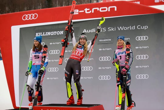 United States' Mikaela Shiffrin, center, winner of the alpine ski, women's World Cup slalom, celebrates on the podium with second placed Slovakia's Petra Vlhova, left, and third placed Sweden's Frida Hansdotter, in Killington, Vt., Sunday, Nov. 25, 2018.
