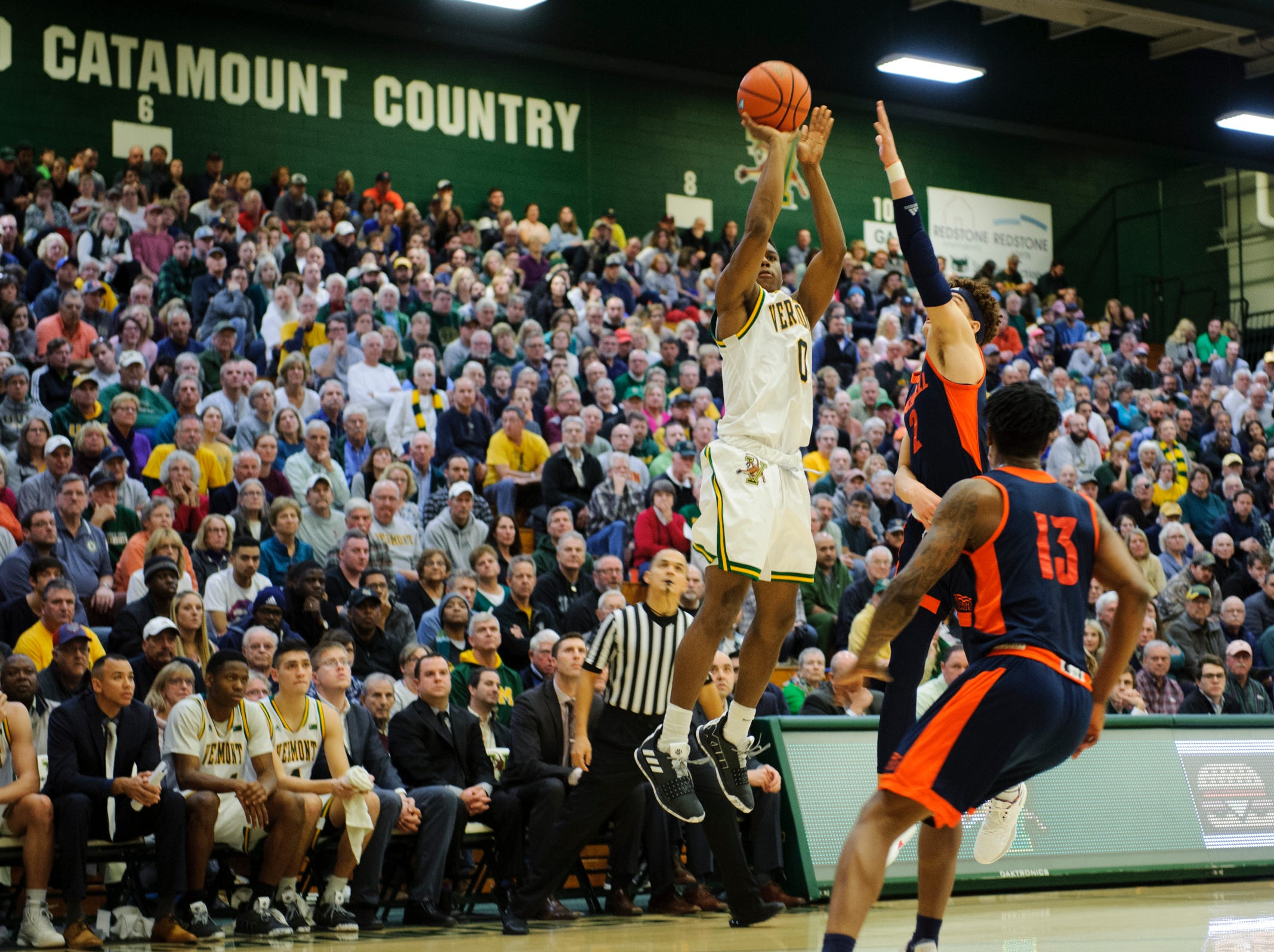Vermont guard Stef Smith (0) shoots a three pointer during the men's basketball game between the Bucknell Bison and the Vermont Catamounts at Patrick Gym on Sunday afternoon November 25, 2018 in Burlington.