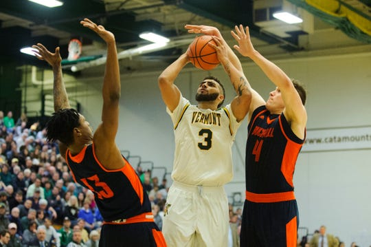 Vermont forward Anthony Lamb (3) leaps to take a shot over Bucknell's Nate Sestina (4) during the men's basketball game between the Bucknell Bison and the Vermont Catamounts at Patrick Gym on Sunday afternoon November 25, 2018 in Burlington.