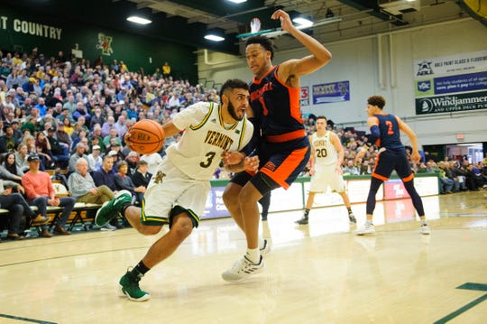 Vermont forward Anthony Lamb (3) drives to the hoop past Bucknell's Kimbal Mackenzie (1) during the men's basketball game between the Bucknell Bison and the Vermont Catamounts at Patrick Gym on Sunday afternoon November 25, 2018 in Burlington.