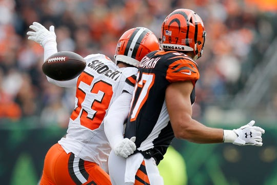 Cleveland Browns middle linebacker Joe Schobert (53) breaks up and nearly intercepts a pass intended for Cincinnati Bengals tight end C.J. Uzomah (87) in the first quarter of the NFL Week 12 game between the Cincinnati Bengals and the Cleveland Browns at Paul Brown Stadium in downtown Cincinnati on Sunday, Nov. 25, 2018.