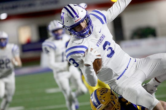 Wyoming quarterback Evan Prater runs the ball during their state semifinal game Saturday, Nov. 24, 2018.