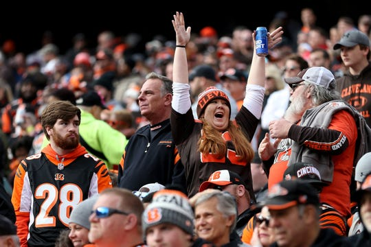 A Cleveland Browns fan celebrates the lead as a Cincinnati Bengals fan, left, reacts in the second quarter of an NFL Week 12 football game, Sunday, Nov. 25, 2018, at Paul Brown Stadium in Cincinnati.
