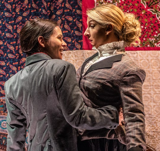 """Jordan Trovillion (L) and Lisa DeRoberts, in a scene from playwright Reina Hardy's """"Susan Swayne and the Bewildered Bride,"""" which runs through Dec. 16 at the Know Theatre of Cincinnati. At times, the two are deadly adversaries. And at other moments, like the one pictured here, they seem on the verge of an entirely different sort of relationship."""