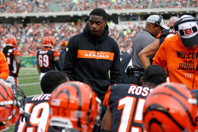 Injured Cincinnati Bengals wide receiver A.J. Green (18) stands on the sideline in the first quarter of the NFL Week 12 game between the Cincinnati Bengals and the Cleveland Browns at Paul Brown Stadium in downtown Cincinnati on Sunday, Nov. 25, 2018.