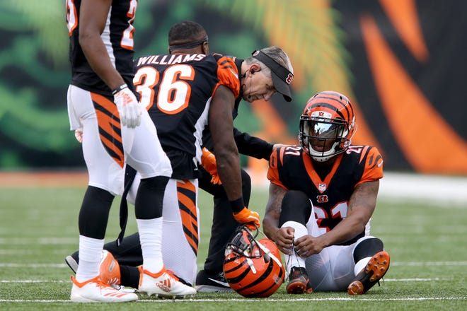 Cincinnati Bengals defensive back Darqueze Dennard (21) is examined for an injury in the third quarter of an NFL Week 12 football game, Sunday, Nov. 25, 2018, at Paul Brown Stadium in Cincinnati. Cleveland Browns won 35-20.