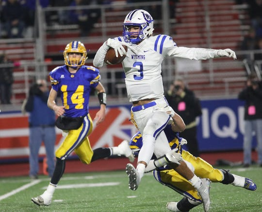 Wyoming Qb Evan Prater (3) runs the ball during their state semifinal game against St. Marys Saturday, Nov. 24, 2018.