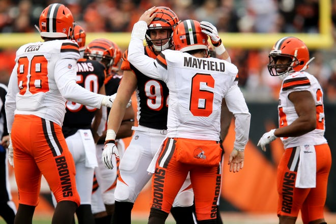 Cincinnati Bengals defensive end Sam Hubbard (94) and Cleveland Browns quarterback Baker Mayfield (6) embrace after a play in the third quarter of an NFL Week 12 football game, Sunday, Nov. 25, 2018, at Paul Brown Stadium in Cincinnati. Cleveland Browns won 35-20.