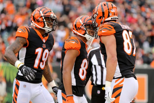 Cincinnati Bengals wide receiver Tyler Boyd (83), center, celebrates a touchdown catch with Cincinnati Bengals wide receiver Auden Tate (19), left, and Cincinnati Bengals tight end C.J. Uzomah (87) in the third quarter of an NFL Week 12 football game, Sunday, Nov. 25, 2018, at Paul Brown Stadium in Cincinnati. Cleveland Browns won 35-20.