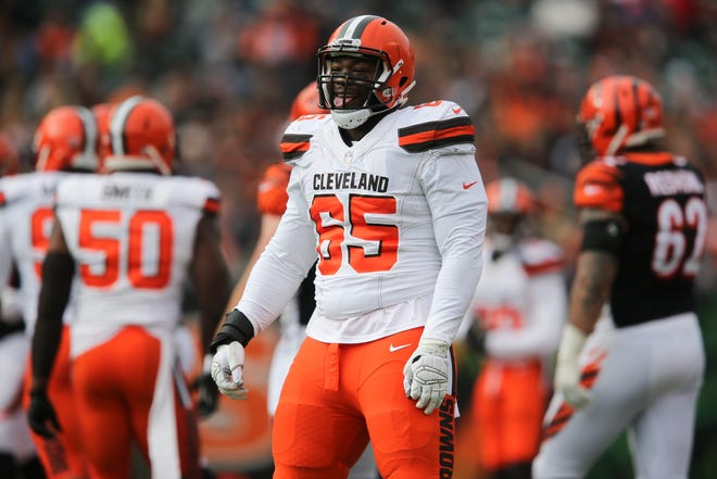 Cleveland Browns defensive tackle Larry Ogunjobi (65) reacts after a tackle for loss in the first quarter of an NFL Week 12 football game, Sunday, Nov. 25, 2018, at Paul Brown Stadium in Cincinnati.