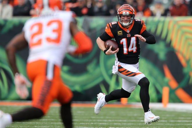 Cincinnati Bengals quarterback Andy Dalton (14) runs in the second quarter of an NFL Week 12 football game, Sunday, Nov. 25, 2018, at Paul Brown Stadium in Cincinnati.