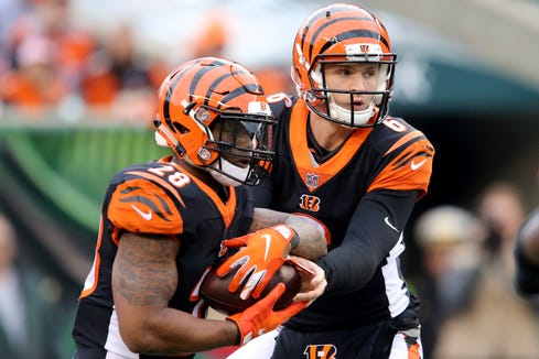 Cincinnati Bengals quarterback Jeff Driskel (6) hands the ball off to Cincinnati Bengals running back Joe Mixon (28) in the fourth quarter of an NFL Week 12 football game, Sunday, Nov. 25, 2018, at Paul Brown Stadium in Cincinnati. Cleveland Browns won 35-20.