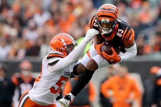 Browns middle linebacker Joe Schobert defends as Bengals wide receiver Tyler Boyd makes a catch last season.