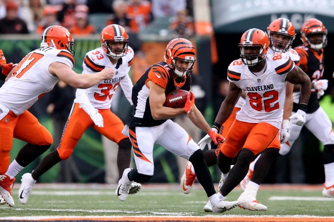 Cincinnati Bengals wide receiver Alex Erickson (12) returns a punt in the fourth quarter of an NFL Week 12 football game against the Cleveland Browns, Sunday, Nov. 25, 2018, at Paul Brown Stadium in Cincinnati. Cleveland Browns won 35-20.