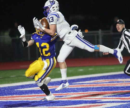 Wyoming wide receiver Joey Edomonds catches a touchdown pass during the Cowboys' 35-14 win over St. Marys in  state semifinal Saturday, Nov. 24, 2018.