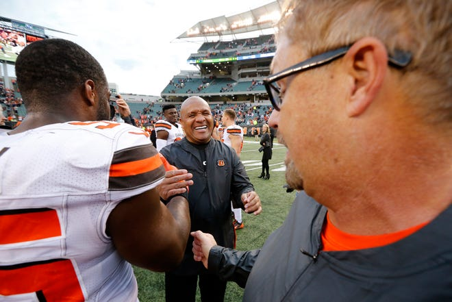 Cincinnati Bengals assistant to the head coach Hue Jackson laughs as he hugs Cleveland Browns head coach Gregg Williams after the fourth quarter of the NFL Week 12 game between the Cincinnati Bengals and the Cleveland Browns at Paul Brown Stadium in downtown Cincinnati on Sunday, Nov. 25, 2018. The Bengals fell 35-20, giving the Browns their first road win since 2015.