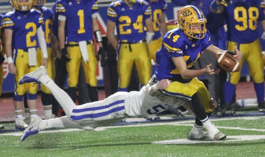 Wyoming  defensive lineman Eli Cupp (53) knocks the ball away from St. Marys quarterback Breadan Dunlap during their state semifinal game Saturday, Nov. 24, 2018.