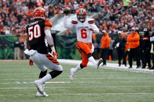 Cleveland Browns quarterback Baker Mayfield (6) pump fakes as he scrambles for a gain in the second quarter of the NFL Week 12 game between the Cincinnati Bengals and the Cleveland Browns at Paul Brown Stadium in downtown Cincinnati on Sunday, Nov. 25, 2018.