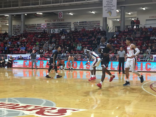 UC senior Cane Broome sets up the Bearcat offense in their championship game with Ole Miss at the Emerald Coast Classic