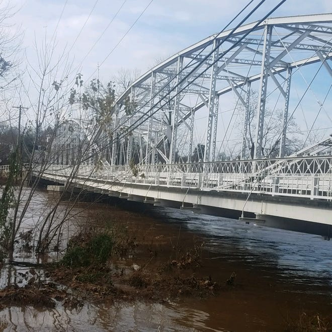 After Saturday night's heavy rain, the Elm Street Bridge over the South Branch of the Raritan River between Branchburg and Hillborough is close to flooding.
