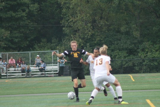 South Brunswick boys soccer player Jake Stump (dark jersey)