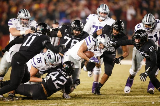 Kansas State's Dalvin Warmack is tackled during their football game at Jack Trice Stadium on Saturday, Nov. 24, 2018, in Ames. Kansas State takes a 21-14 lead into halftime.