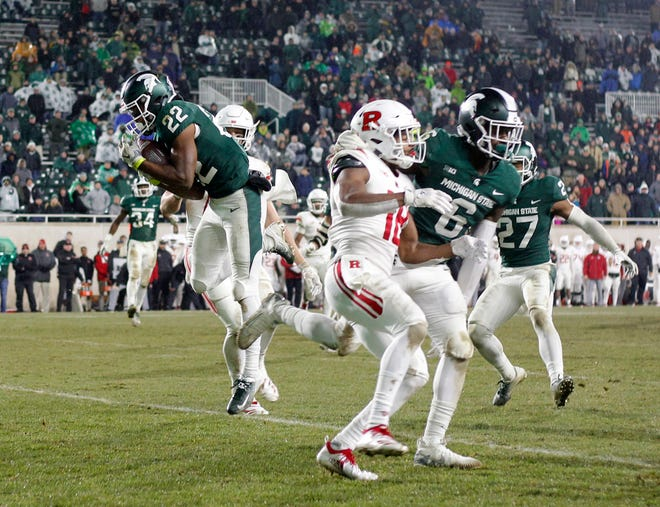 Michigan State's Josiah Scott intercepts a pass against Rutgers late in the fourth quarter Saturday, Nov. 24, 2018 at Spartan Stadium.