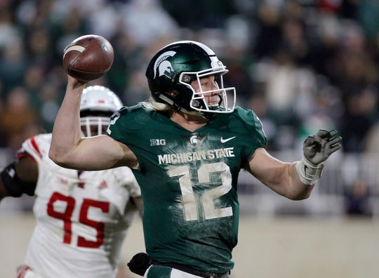 Michigan State quarterback Rocky Lombardi prepares to pass against Rutgers pursues during the second quarter Saturday, Nov. 24, 2018, in East Lansing.