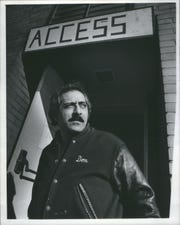Don Unis stands in doorway of the Arab community center on Jan. 19, 1976.