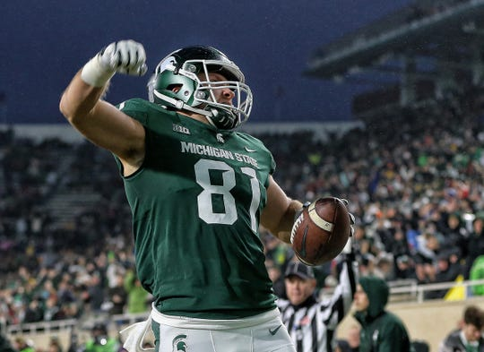 Michigan State tight end Matt Sokol celebrates his touchdown during the first half against Rutgers at Spartan Stadium, Nov. 24, 2018, in East Lansing.