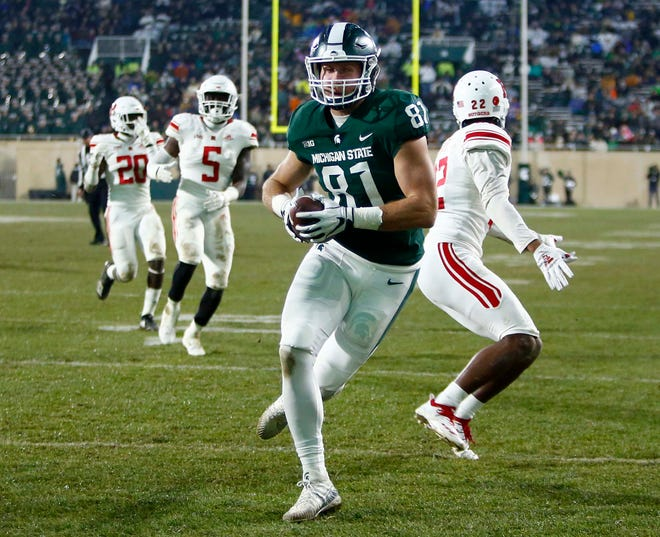 Michigan State tight end Matt Sokol scores a touchdown against Rutgers in the second quarter at Spartan Stadium on Nov. 24, 2018 in East Lansing.