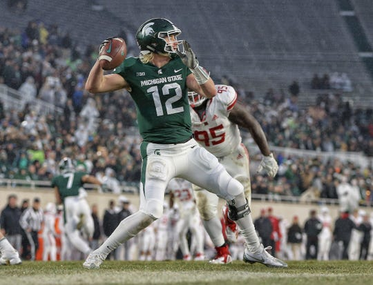 Michigan State quarterback Rocky Lombardi drops back to pass during the first half against Rutgers at Spartan Stadium on Nov. 24, 2018 in East Lansing.