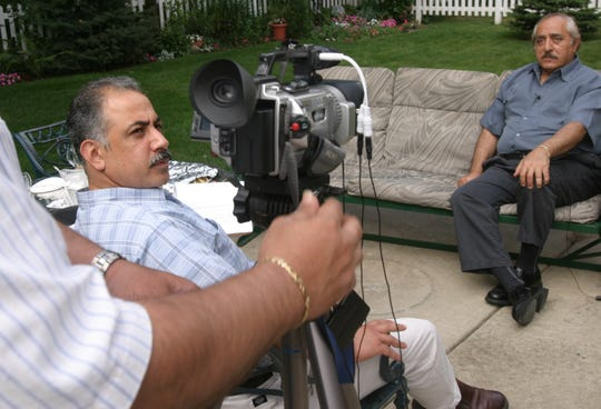 """Thursday, July 8, 2004, in Dearborn, Mich. Neal Abunab, 42, of Dearborn looks back as he interviews Don Unis, right, 65, of Dearborn, who is a prominent Arab- Muslim community activist for Abunab's film, """"The Arab-American Dream,"""" Abunab said, """"Don Unis is a symbol of activism in the Arab- American community. He is a part of the story I am telling in my movie."""""""