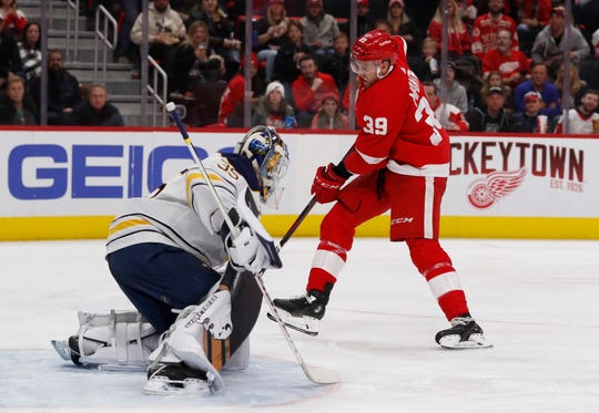 Sabres goaltender Linus Ullmark (35) stops a shot-on-goal by Red Wings right wing Anthony Mantha (39) during the second period of the Wings' 3-2 loss on Saturday, Nov. 24, 2018, at Little Caesars Arena.