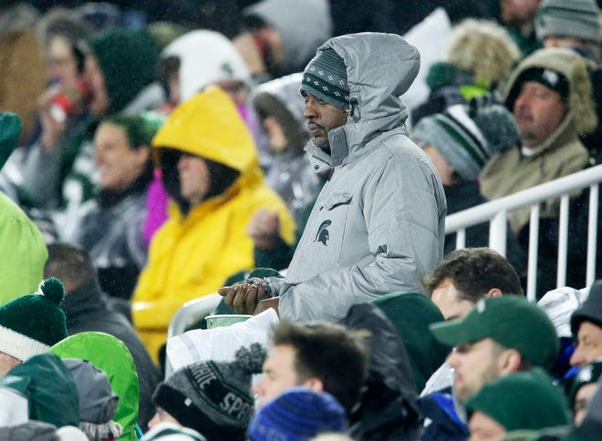 Michigan State fans are bundled up against the rain and cold during the first half against Rutgers, Saturday, Nov. 24, 2018, in East Lansing.