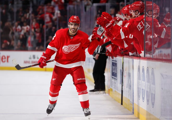 Red Wings center Andreas Athanasiou celebrates a goal with teammates during the shootout of the Wings' 3-2 loss on Saturday, Nov. 24, 2018, at Little Caesars Arena.