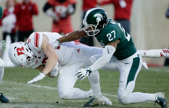 Rutgers tight end Travis Vokolek scores past Michigan State safety Khari Willis on a pass play during the first quarter at Spartan Stadium on Nov. 24, 2018 in East Lansing.