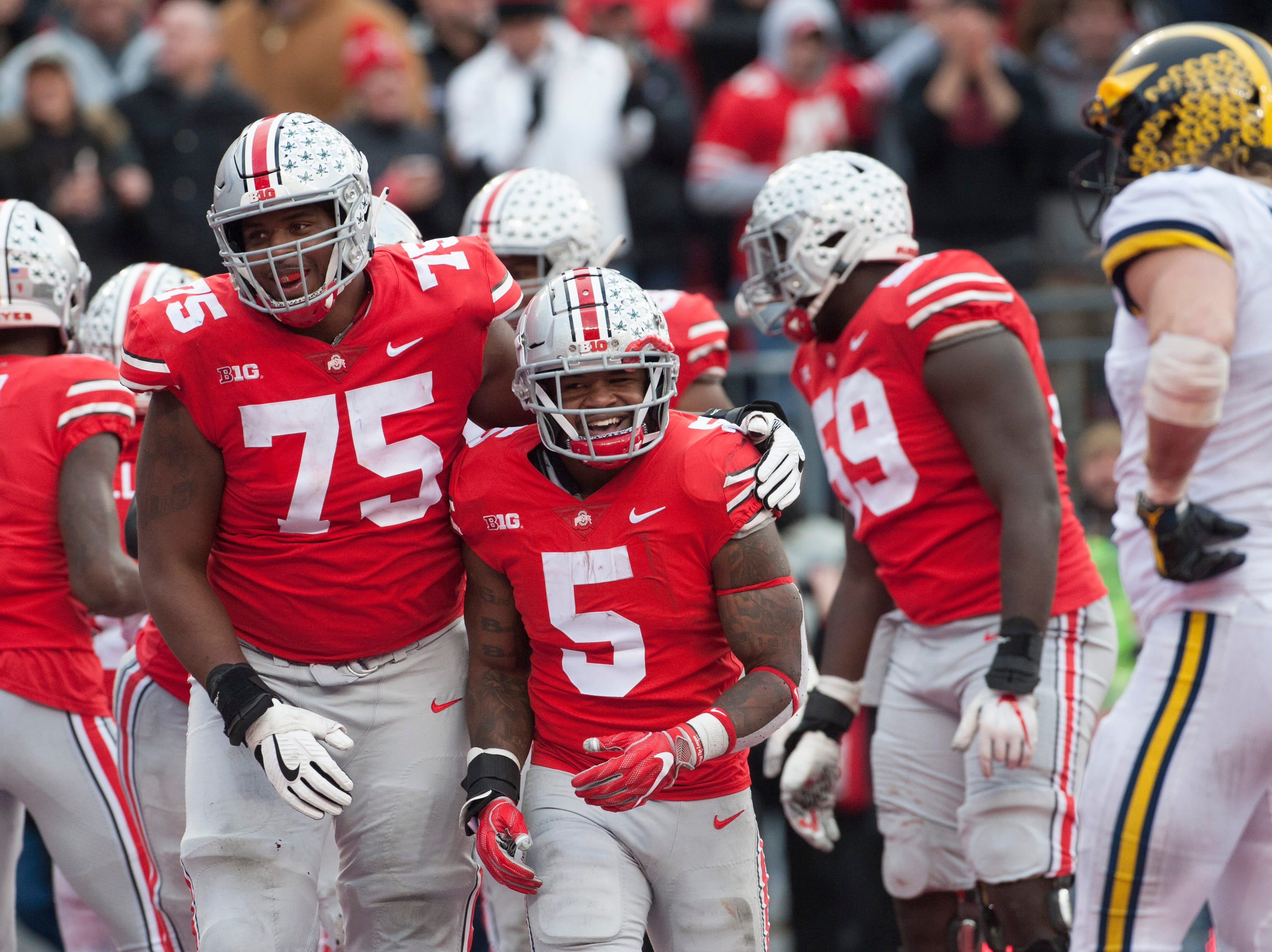 1. Ohio State (11-1, 8-1) – For all the talk about the Buckeyes being down this year, it sure didn't look like it on Saturday as the top scoring offense in the Big Ten ran roughshod over Michigan's No. 1 defense. From nearly losing on the road to Maryland last week to the domination of the Wolverines, the Buckeyes now head to the conference title game with a shot at reaching the College Football Playoff. Last week: 2.