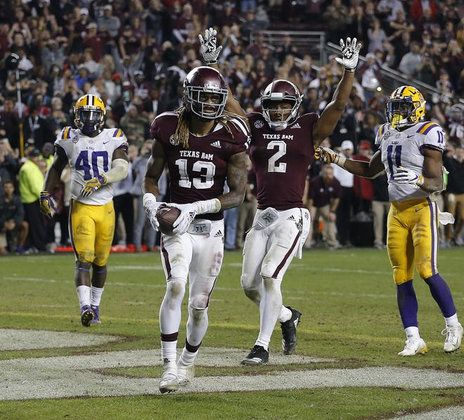 Kendrick Rogers of the Texas A&M Aggies scores  the winning two-point conversion in the seventh overtime period.