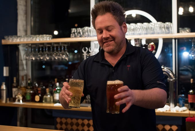 Bartender Byran Sumner serves beer at Myriad Brewing located in the lobby of The McCurdy Wednesday Nov. 21, 2018.